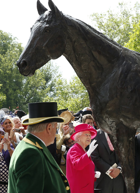Britain's Queen Elizabeth II looks at the newly unveiled statue to the undefeated racehorse Frankel on the first day of  Royal Ascot horse racing meet at Ascot, England, Tuesday, June 16, 2015. Royal Ascot is the annual five day horse race meeting that Britain's Queen Elizabeth II attends every day of the event. (AP Photo/Alastair Grant)