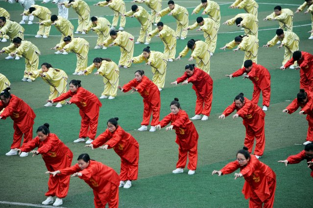 Students perform Wu Qin Xi, a type of qigong, during a competition in Bozhou, Anhui Province, China, April 20, 2016. (Photo by Reuters/Stringer)
