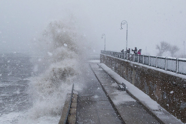 People watch as waves crash over the seawall along Lynn Shore Drive as Winter Storm Stella bears down on March 14, 2017 in Lynn, Massachusetts. (Photo by Scott Eisen/Getty Images)