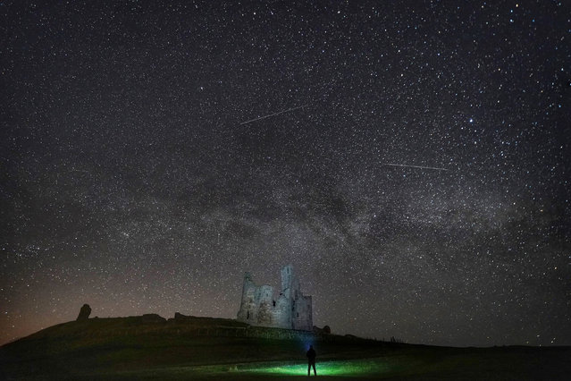 The Milky Way and millions of stars over Dunstanburgh Castle, Northumberland, England in the early hours of Thursday morning, April 11, 2019. (Photo by Owen Humphreys/PA Wire Press Association)