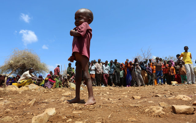 An internally displaced Somali child stands among other people who have fled from drought stricken regions at a makeshift camps in Baidoa, west of Somalia's capital Mogadishu, March 26, 2017. (Photo by Feisal Omar/Reuters)