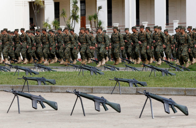 Chilean soldiers are seen next to rifles in the courtyard of a regiment during a military training session of the army in Valparaiso, Chile, May 6, 2016. (Photo by Rodrigo Garrido/Reuters)