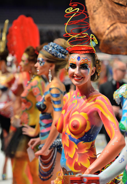 "Models waits for the rating of the jury during the ""Body Painting"" contest of the OMC Hairworld World Cup on May 4, 2014 in Frankfurt am Main, Germany. (Photo by Thomas Lohnes/Getty Images)"