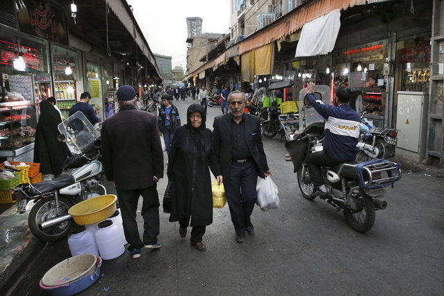 Iranians shop in a market in central Tehran, Iran, Sunday, February 28, 2016. (Photo by Vahid Salemi/AP Photo)