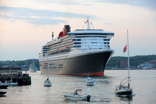 Followed by the Royal Canadian Navy's Frigate HMCS Montreal, Queen Mary 2 departs from Halifax, Nova Scotia, Friday, July 10, 2015. This month marks the 175th Anniversary of Cunard, and the company's flagship, Queen Mary 2, has recreated the historic Transatlantic Crossing from Liverpool to Halifax made by the RMS Britannia in July 1840. (Photo by Diane Bondareff/AP Images for Cunard)