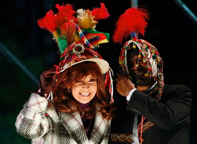 Argentina's President Cristina Fernandez de Kirchner and her Bolivian counterpart Evo Morales smile as they wear typical Bolivian hats during a ceremony outside the Casa Rosada Presidential Palace in Buenos Aires, July 15, 2015. (Photo by Marcos Brindicci/Reuters)