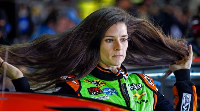 Driver Danica Patrick runs her hands through her hair before practice for NASCAR Sprint Cup series auto race at Charlotte Motor Speedway in Concord, N.C., on May 16, 2014. (Photo by Terry Renna/Associated Press)