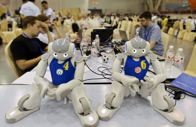 Robots are placed on a desk as participants prepare for the upcoming RoboCup 2015, at an exhibition centre in Hefei, Anhui province, China, July 18, 2015. Over 2,000 people have registered to join the RoboCup in Hefei this year which will be held from July 19 to July 23, local media reported. (Photo by Reuters/Stringer)