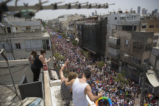Tens of thousands people participate in the annual Gay Pride Parade in Tel Aviv, Israel, Friday, June 3, 2016. (Photo by Oded Balilty/AP Photo)