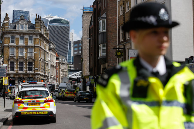A police officer stands at a police cordon near the scene of a terror attack in London, U.K., on Sunday, June 4, 2017. A van swerved into Saturday-night crowds on London Bridge, before three men got out and went on a stabbing rampage through nearby bars. (Photo by Luke MacGregor/Bloomberg)