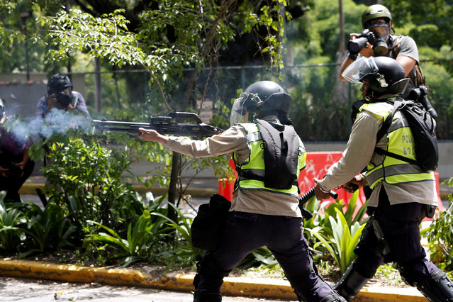 A riot police fires rubber bullets towards demonstrators during a protest called by university students against Venezuela's government in Caracas, Venezuela, June 9, 2016. (Photo by Carlos Garcia Rawlins/Reuters)
