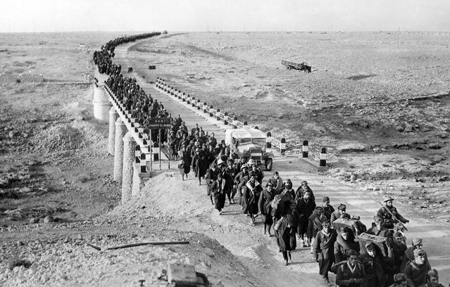 Bardia, a fortified Libyan seaport, was captured by British forces, with more than 38,000 Italian prisoners, including four generals, and vast quantities of war material. An endless stream of Italian prisoners leaves Bardia, on February 5, 1941, after the Australians had taken possession