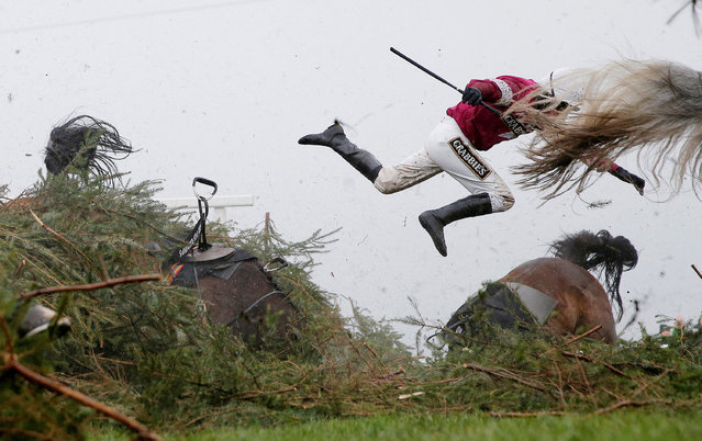 Jockey Nina Carberry flies off her horse Sir Des Champs as they fall at The Chair fence during the Grand National steeplechase during day three of the Grand National Meeting at Aintree Racecourse on April 9th 2016 in Liverpool, England. (Photo by Tom Jenkins/Reuters/The Guardian/Courtesy of World Press Photo Foundation)