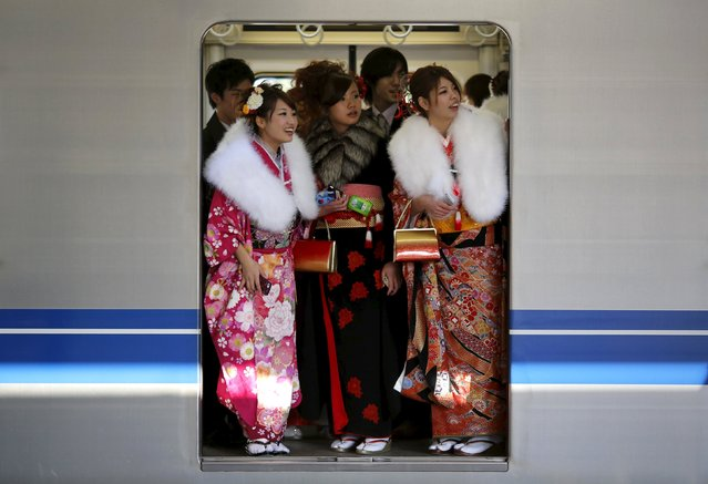Japanese women in kimonos ride a train after a ceremony celebrating Coming of Age Day at an amusement park in Tokyo in this January 13, 2014 file photo. Japan is expected to release consumer confidence data this week. (Photo by Yuya Shino/Reuters)