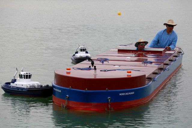A Panama Canal pilot maneuvers a scale cargo boat during a training day at the scale model maneuvering training facility of the Panama Canal, a day before the inauguration of the Panama Canal Expansion project on the outskirts of Panama City, in Panama June 25, 2016. (Photo by Alberto Solis/Reuters)