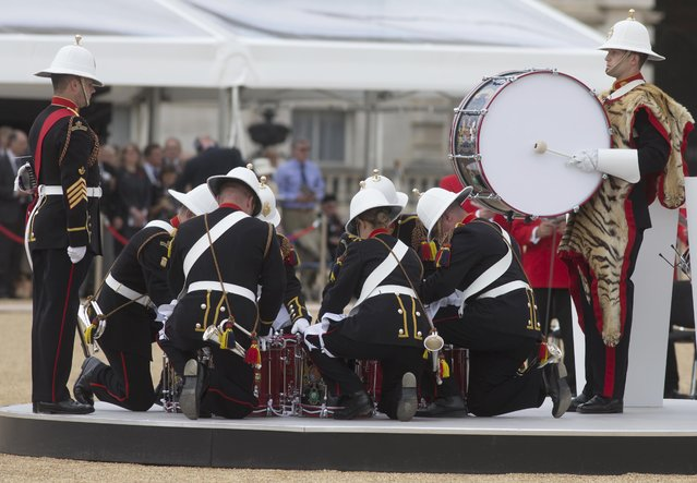 A ceremonial drum head is constructed at a service to commemorate the 70th anniversary of VJ Day at Horse Guards Parade in London, Britain August 15, 2015. (Photo by Neil Hall/Reuters)