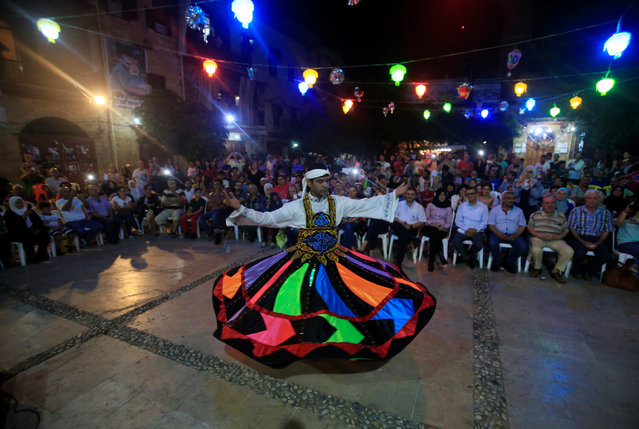 A whirling Dervish performs on stage during the Muslim fasting month of Ramadan in Sidon, southern Lebanon June 29, 2016. (Photo by Ali Hashisho/Reuters)