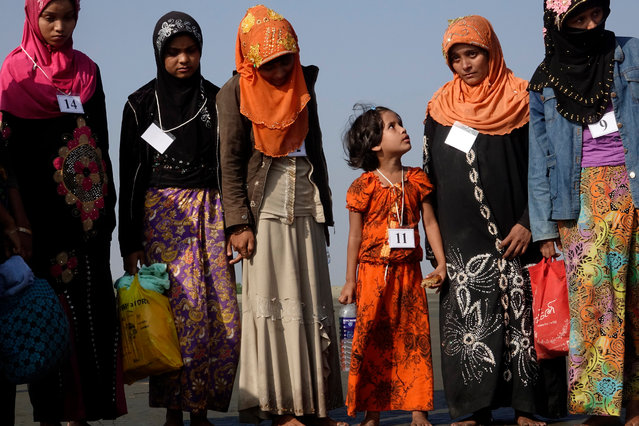 A group of 17 Muslim migrants arrive at the Thae Chaung village in Sittwe, Rakhine State, Western Myanmar, 13 January 2020. 17 people, including children and women believed to have fled the state of Rakhine and Bangladesh, were arrested on 15 December 2019 as they arrived on the shores of Kawthaung District. They were sent back to Sittwe by Navy ships. Authorities arranged temporary shelter for the group at the Sai Tha Mar Gyi village near Sittwe. (Photo by Nyunt Win/EPA/EFE)