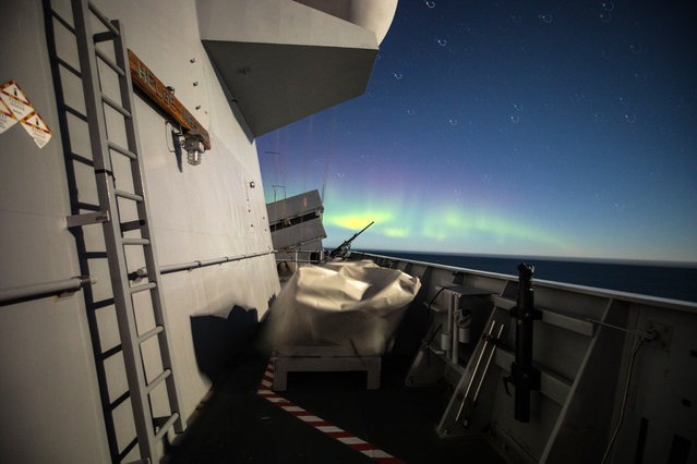 A handout photo made available by the Norwegian Armed Forces on 01 November 2018 shows Northern lights from KNM Helge Ingstad during Trident Juncture excercise in Norway, 29 October 2018. According to reports, some 50,000 participants from over 30 nations are expected to take part in the NATO-led military exercise in Norway from 25 October to 23 November 2018. (Photo by Marius Vågenes Villanger/EPA/EFE)
