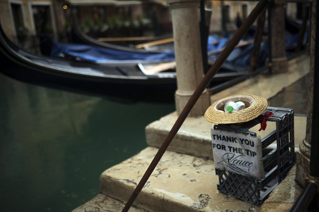 Gondolas are parked on a rainy day in Venice, Sunday, March 1, 2020. Italian tourism officials are worrying a new virus could do more damage to their industry than the Sept. 11 terror attacks. (Photo by Francisco Seco/AP Photo)