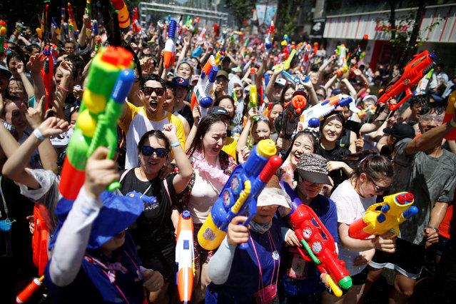 Participants play with water guns during Sinchon Water Gun Festival in Seoul, South Korea, July 9, 2016. (Photo by Kim Hong-Ji/Reuters)