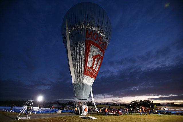 """Fedor Konyukhov prepares to depart at Northam Aero Club on July 12, 2016 in Northam, Australia. The 65 year old Russian adventurer aims to set a new world record by circumnavigating the globe without touching down in under 13 days. The current record of 13.5 days was set by American aviator Steve Fossett in 2002. Fedor Konyukhov will travel almost 33,000km in his balloon Rosiere balloon """"Morton"""" which is 52 metres high and weighs 1,600kg. (Photo by Paul Kane/Getty Images)"""