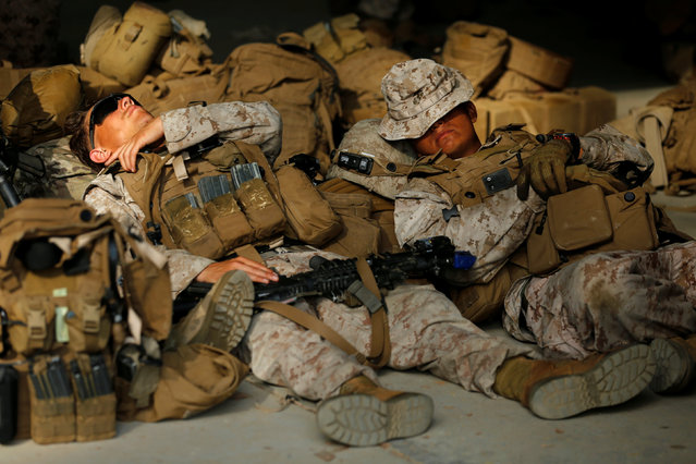 U.S. Marines catch some sleep at sunrise during multi-day training as part of the Rim of the Pacific (RIMPAC) 2016 exercise held at Camp Pendleton, California United States, July 13, 2016. (Photo by Mike Blake/Reuters)