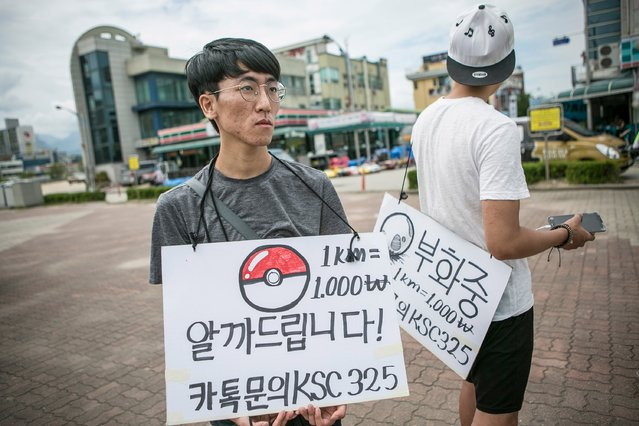 South Korean youths who makes allowance by subsituting the process of opening the eggs in the first few kilometers of Pokemon Go look for customers on July 15, 2016 in Sokcho, South Korea. (Photo by Jean Chung/Getty Images)