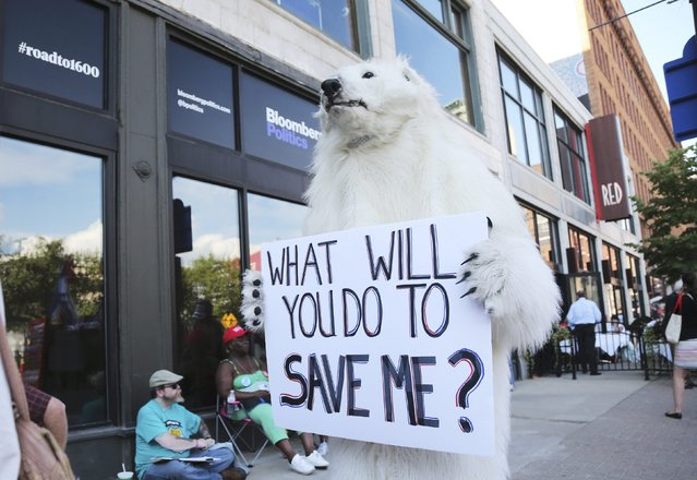 A protestor dressed as a polar bear walks down the street near the Republican National Convention in Cleveland, Ohio, U.S. July 18, 2016. (Photo by Aaron Josefczyk/Reuters)