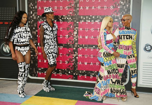 Amber Rose (R) and Blac Chyna (2nd R) arrive with guests at the 2015 MTV Video Music Awards in Los Angeles, California, August 30, 2015. (Photo by Danny Moloshok/Reuters)