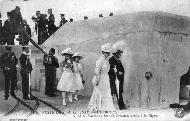 Tsar Nicholas II of Russia and his family in Cherbourg during a state visit to France, circa 1909. The Tsarina is on the arm of the French president Fallieres.