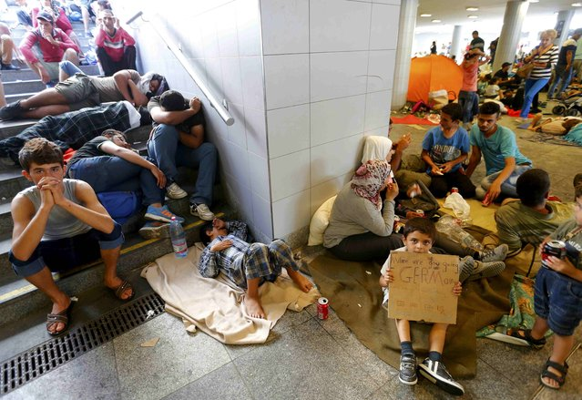 Migrants rest in an underground passage near to Keleti train starion in Budapest, Hungary September 2, 2015. (Photo by Laszlo Balogh/Reuters)