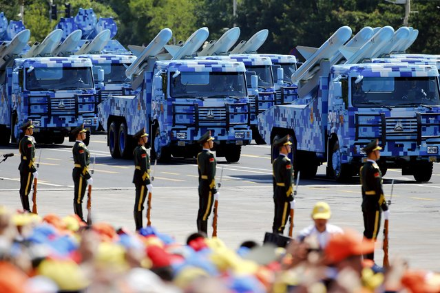 China's People's Liberation Army (PLA) navy soldiers on their armoured vehicles carrying ship-to-air missiles roll to Tiananmen Square during the military parade marking the 70th anniversary of the end of World War Two, in Beijing, China, September 3, 2015. (Photo by Damir Sagolj/Reuters)