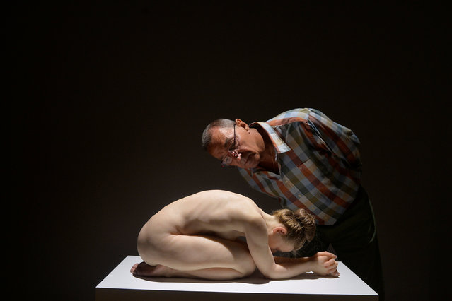 """A visitor observes the sculpture """"Kneeling Woman"""" by Australian artist Sam Jinks, at the Hyperrealist Sculpture 1973-2016 exhibition in the Museum of Bellas Artes in Bilbao, northern Spain, July 27, 2016. (Photo by Vincent West/Reuters)"""