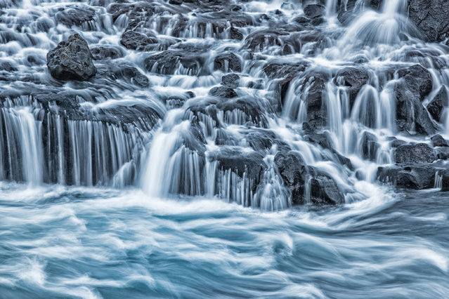 Winner, Special Category Award: Water. Britta Strack – The Play of Water. Hraunfossar Island. (Photo by Britta Strack/2020 GDT Nature Photographer of the Year)