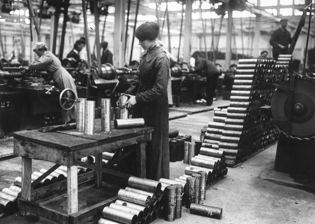 Women munitions workers in a Vickers factory maing shell cases, January 1915. (Photo by Topical Press Agency)