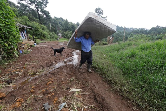 A man carries a mattress recovered from his house, which was damaged by a mudslide, in the aftermath of Tropical Storm Earl in the town of Huauchinango, in Puebla state, Mexico, August 8, 2016. (Photo by Imelda Medina/Reuters)