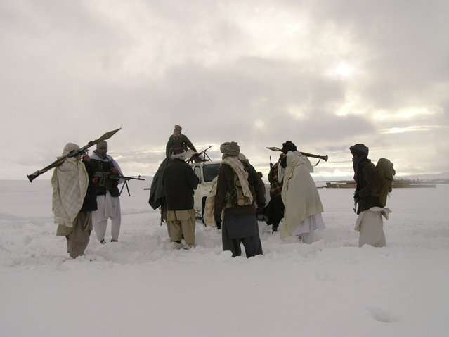 In this picture released exclusively to Reuters on January 17, 2009, Taliban militants are seen with their weapons in an undisclosed location in Afghanistan January 16, 2009. (Photo by Reuters/Stringer)
