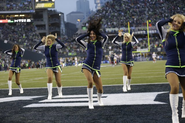 Seattle Seahawks cheerleaders perform against the San Francisco 49ers during the first half of the NFL football NFC Championship game Sunday, January 19, 2014, in Seattle. (Photo by Marcio Jose Sanchez/AP Photo)