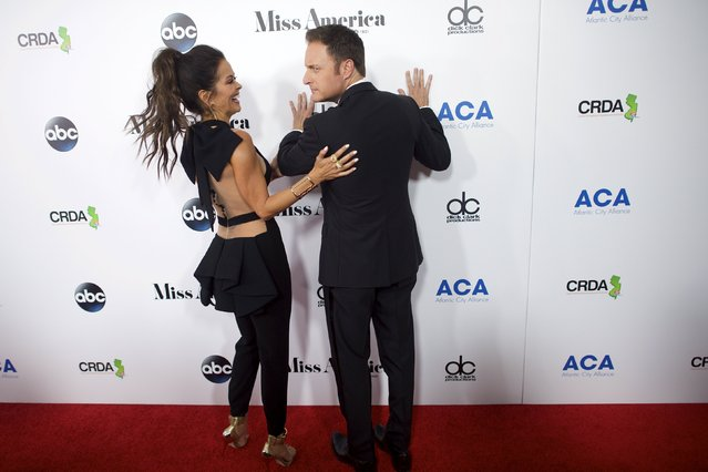 Hosts (L-R) Brooke Burke-Charvet and Chris Harrison arrive on the red carpet in Boardwalk Hall, the venue for the 95th Miss America Pageant, that takes place tonight in Atlantic City, New Jersey, September 13, 2015. (Photo by Mark Makela/Reuters)
