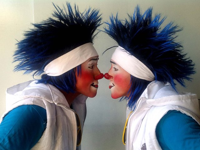 Caitio, 21, and his brother Lunarcito, 20, pose for photos during Mexico's 17th annual clown convention, La Feria de la Risa, in Mexico City, October 24, 2012. (Photo by Anita Baca/AP Photo)