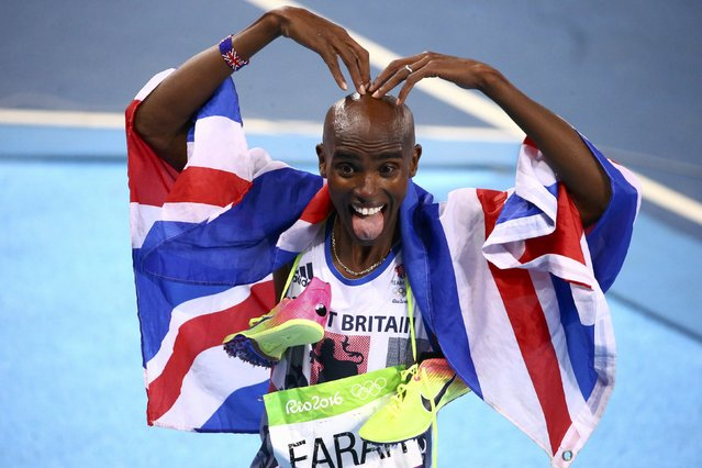 2016 Rio Olympics, Athletics, Final, Men's 5000m Final, Olympic Stadium, Rio de Janeiro, Brazil on August 20, 2016. Mo Farah (GBR) of Britain celebrates after winning the race. (Photo by David Gray/Reuters)