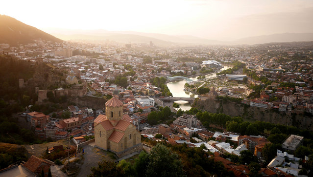 The Mtkvari River winding through Tbilisi, Georgia. (Photo by Amos Chapple/Rex Features)