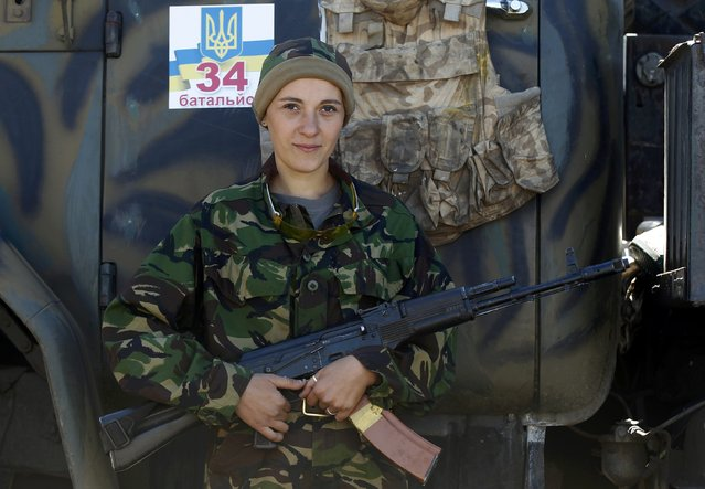 A Ukrainian servicewoman stands in Horlivka, September 18, 2014. (Photo by Shamil Zhumatov/Reuters)