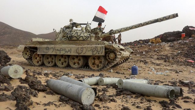 A soldier loyal to Yemen's government rides on a tank in the frontline province of Marib, September 19, 2015. (Photo by Reuters/Stringer)