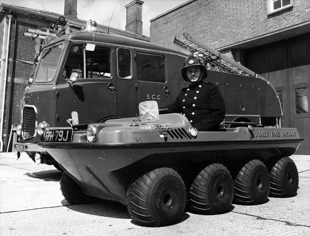 Fireman Bainbridge in the argocat at Reigate fire station, Surrey, 1971. The new vehicle has been designed by a company in Canada where it is used for forestry work, duck shooting and as a beach runabout. Completely amphibious, and equipped with balloon tyres and a two-stroke 436cc engine, the vehicle can carry up to six men and a portable pump and hose. It is intended for commando style fire-fighting in inaccessible places. (Photo by Wesley/Keystone)