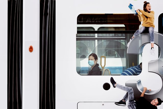 A woman is sitting in a tram in Zurich on July 21, 2020. A protective mask is also required on public transport throughout Switzerland. (Photo by Annick Ramp/NZZ)