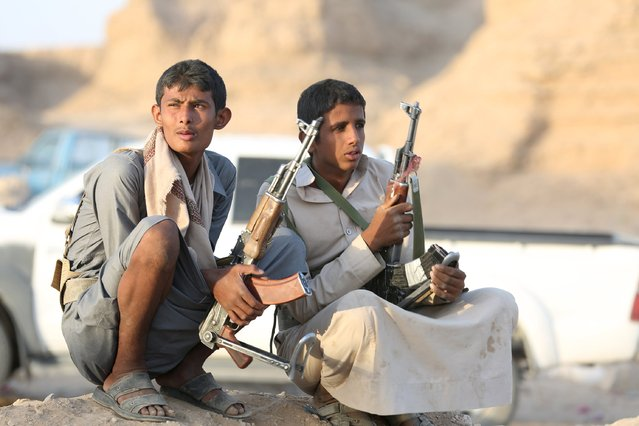 Tribal fighters loyal to Yemen's government sit at the frontline of fighting against Houthi militants in the central province of Marib September 30, 2015. Tribal fighters backed by a Saudi-coalition won control of a strategic dam in Marib from Houthi forces on Tuesday but lost ground in the south near the port of Aden, where President Abd-Rabbu Mansour Hadi's government is based, residents and officials said. (Photo by Reuters/Stringer)