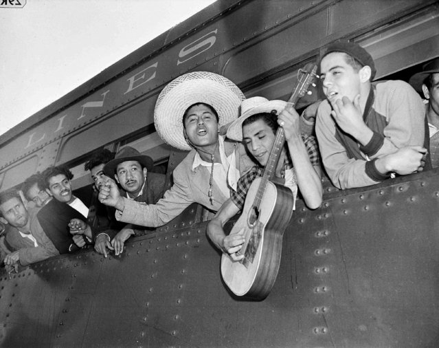 Part of a group of 500 young Mexicans have arrived to alleviate the harvest labor shortage in Stockton, Calif., September 29, 1942. Here, a group of singing, cheering youths. (Photo by Ernest King/AP Photo)