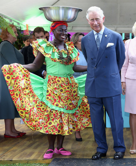 Prince Charles, Prince of Wales meets Carribbean Themed guests at a Sustainability Fair at the Ambassador's Residence on October 29, 2014 in Bogota, Colombia. The Royal Couple are on a four day visit to Colombia as part of a Royal tour to Colombia and Mexico. After fifty years of armed conflict in Colombia the theme for the visit is Peace and Reconciliation. (Photo by Chris Jackson/Getty Images)